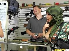 showing their guns in a gun shop for green