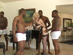 Daring blonde enjoys riding big black cocks in this interracial gang bang action