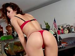 Sexy secretary Bety sits on the desk and fingers her snatch