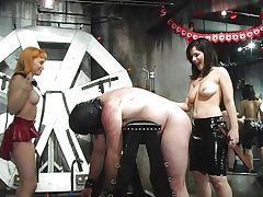 Hot mistresses spanking bonded guy