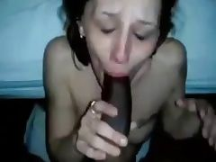 white tattoo chick giving BJ