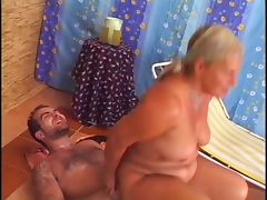 Gorgeous granny rimms and fucks a guy