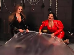 Rubber slave abused by two girls