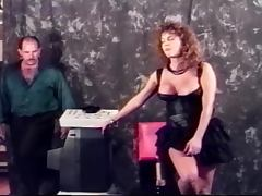 Busty curly haired honey gets fucked doggy style