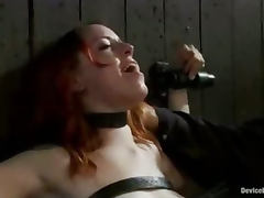 Bound redhead rides sybian and choked