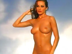 Tanned babe Kyla Cole is showing off her slender shape
