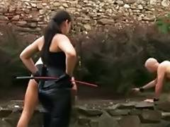 a Dominant Bitch tortures hers working slaves