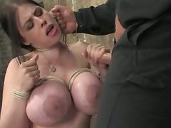 Curvy brunette Daphne Rosen gives a handjob in a terrific BDSM clip