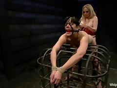 Aiden Starr restrains Bobbi Starr before fucking her with a strapon