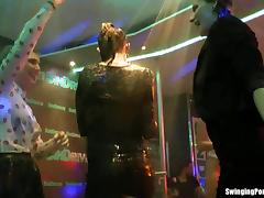 Wet girls dancing erotically in a club