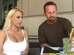 Busty blonde Holly Halston gives a titjob and takes a ride on a prick